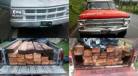 Policías estatales aseguran vehículos con madera en Tenango