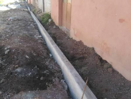 Construyen guarniciones y banquetas en La Explanada; Santiago Tulantepec1